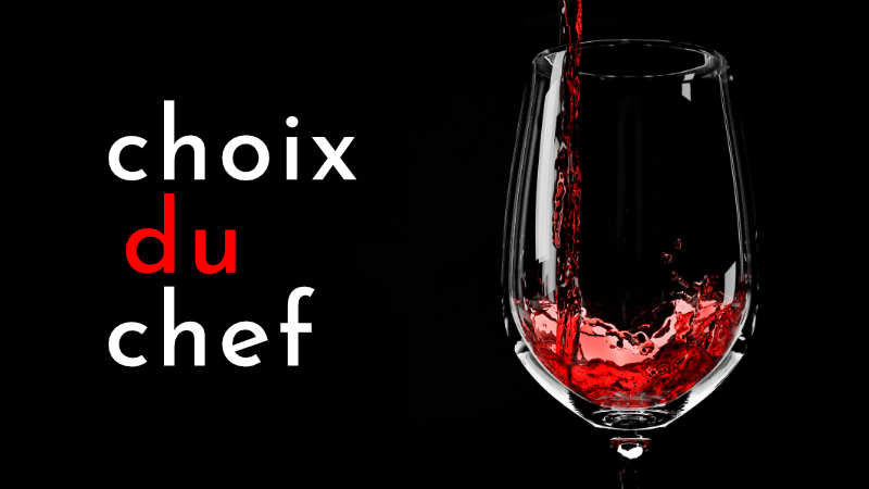 Glass of red wine next to Choix du Chef logo